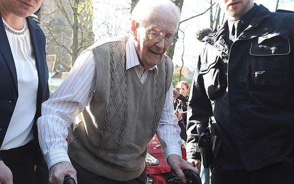 Defendant Oskar Groening arrives for his trial in Luneburg yesterday