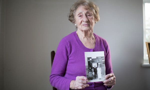 Susan Pollack holds a picture of her with her parents, who were killed in the Holocaust. Photograph: Graeme Robertson
