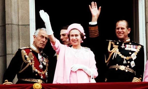 Earl Mountbatten of Burma, the Queen and the Duke of Edinburgh wave from the balcony of Buckingham Palace after the silver jubilee procession