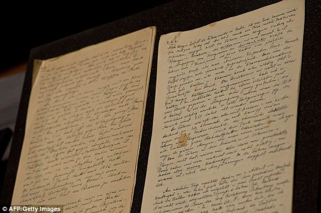 Pages dated February 7, 1940 (left) and February 2, 1941 (right) from the diary of German Nazi ideologue Alfred Rosenberg are displayed at the Holocaust Memorial Museum