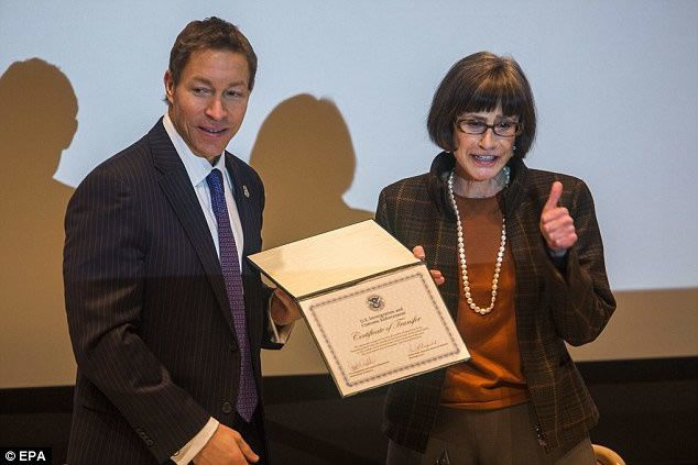 Immigration and Customs Enforcement Deputy Director Daniel Ragsdale (left) transfers the Rosenberg Diary to Holocaust Memorial Museum Director Sara Bloomfield (right) during a ceremony on Tuesday