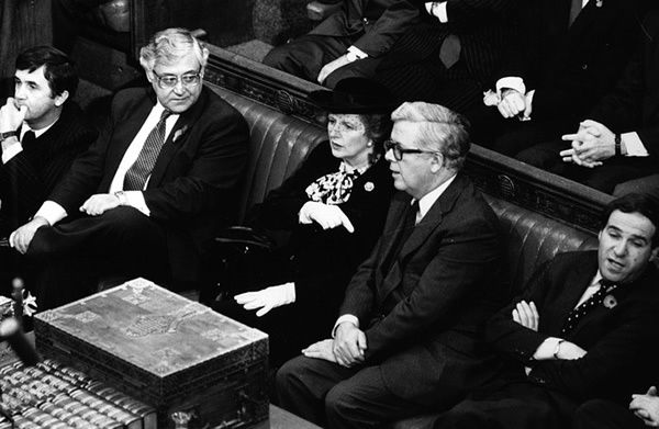 Thatcher and Howe seated in the Commons, waiting to be summoned by Black Rod in 1984