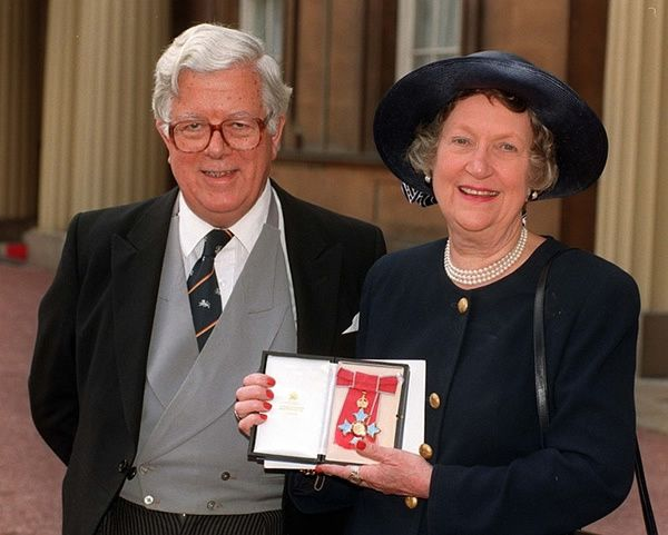 Lord and Lady Howe at Buckingham Palace, following an investiture ceremony during which she received a CBE from the Queen