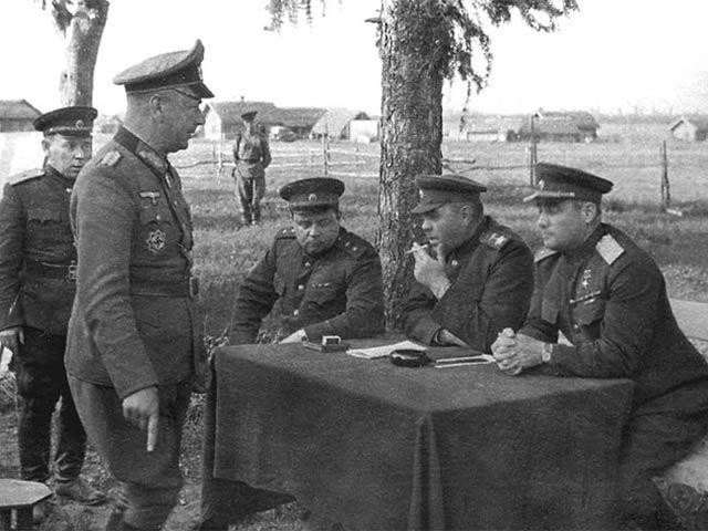 Generalleutnant Alfons Hitter, standing, is publicly interrogated by General Ivan Chernyakhovsky and Marshal of the Soviet Union Aleksandr Vasilevsky after the battle of Vitebsk