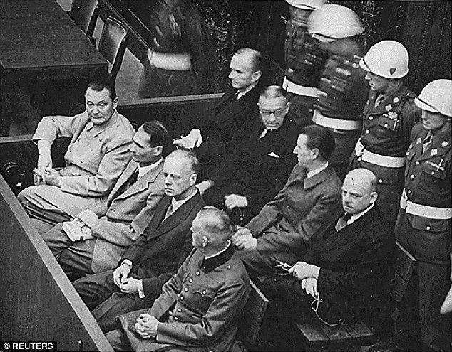 Nazi defendants (L-R front row) Field Marshall Hermann Goering, Adolf Hitler's deputy Rudolf Hess, Joachim Von Ribbentrop (Hitler's Foreign Minister) and Wilhelm Keitel sit in the dock of their war crimes trial at Nuremberg