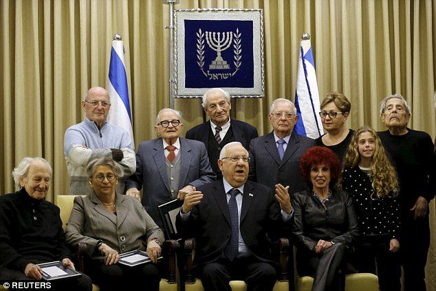 The letter was released to mark Holocaust Memorial Day and current Israeli president Reuven Rivlin, pictured centre, said he would like the document to be put on display at Israel's Yad Vashem Holocaust memorial
