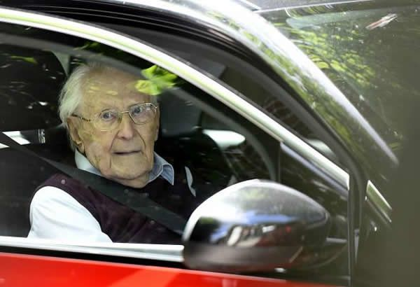 Convicted former SS officier Oskar Groening leaves after the verdict in this trial in Lueneburg, Germany