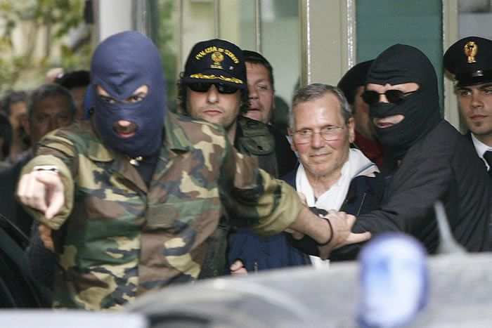 Bernardo Provenzano, center, escorted by police officers in Palermo, Sicily, after his arrest in 2006. He had spent four decades as a fugitive