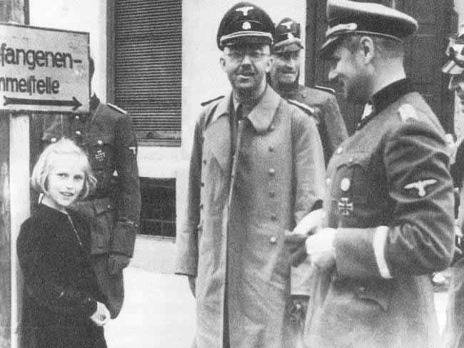 Nazi leader Heinrich Himmler and his daughter Gudrun visiting a concentration camp
