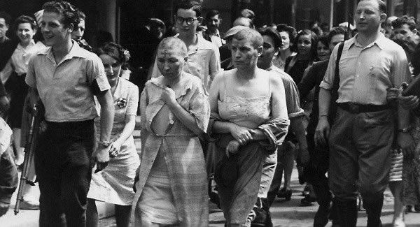 Women accused of collaboration with the Nazis are paraded through Paris in 1944
