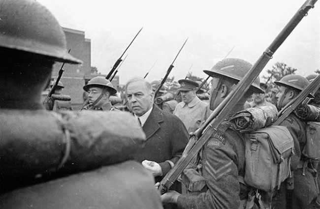 King inspects Canadian troops during a 1941 visit to wartime England. This particular regiment would be the only French-Canadian troops to fight on D-Day
