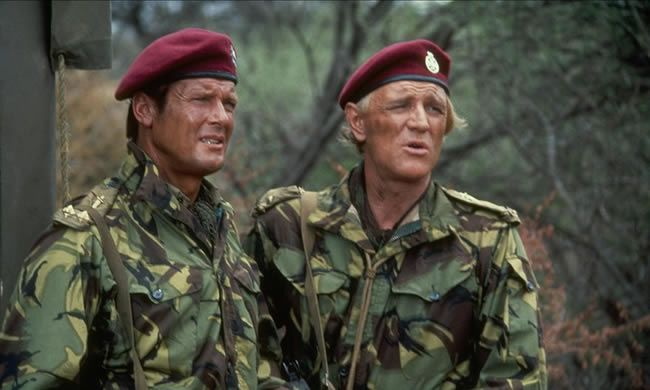 Roger Moore with Richard Harris in The Wild Geese, 1978 Photograph: Allstar/Rank