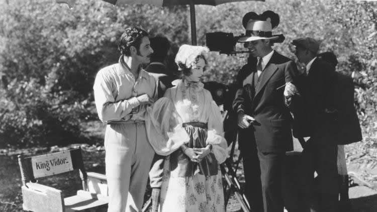 "John Gilbert, left, Lillian Gish and director King Vidor on the set of ""La Bohème."" (Turner Broadcasting System, Inc.)"