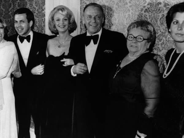 Actor Frank Sinatra, center, poses with his family during an awards presentation, from left, daughter Nancy Sinatra, son Frank Sinatra Jr., Barbara Sinatra, mother Dolly Sinatra, and daughter Tina Sinatra in Los Angeles on November 19, 1976. (Photo: AP)