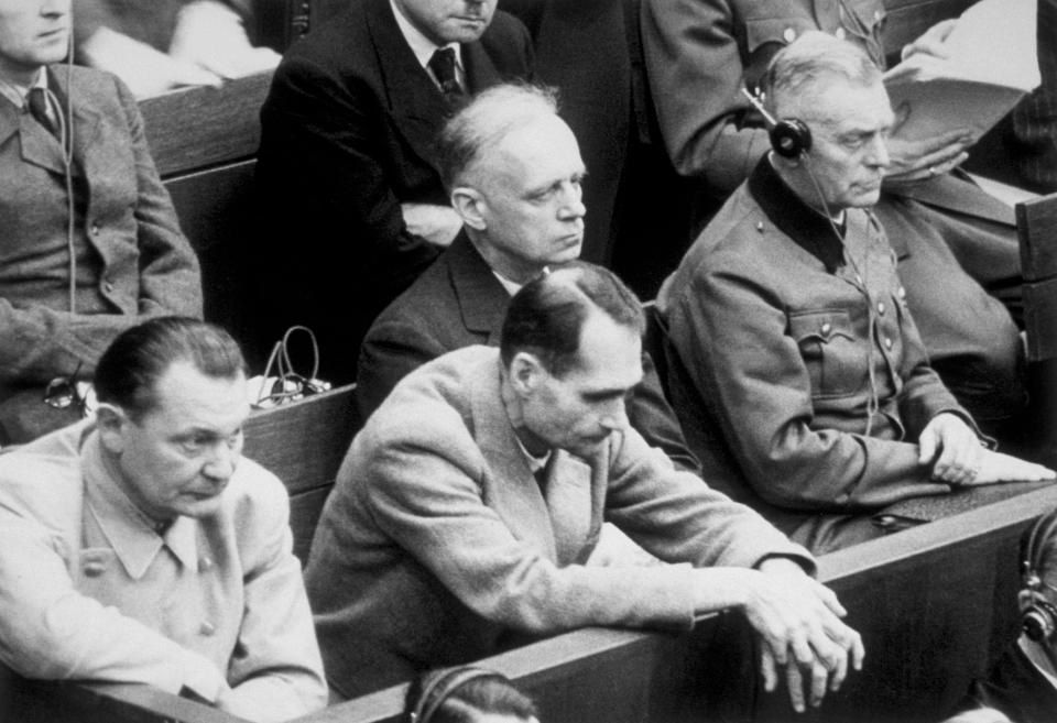 Hess, pictured at the Nuremberg Trials, justified his racial politics with occult nonsense