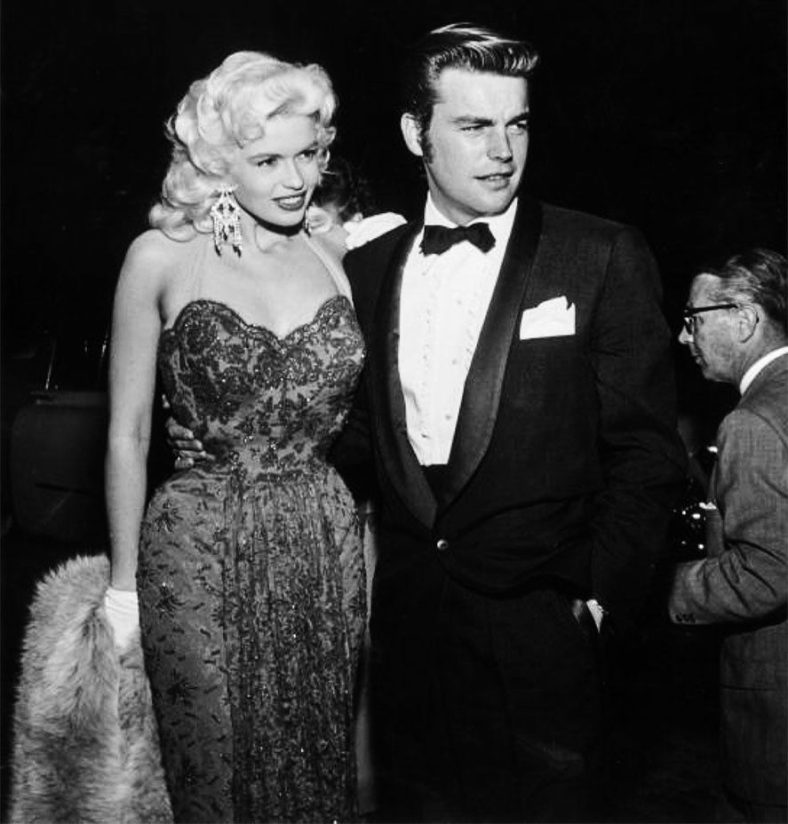 """If you put a goose in a bag, you can still make out its bill and its tail. I'm a lot like that goose — I can't hide anything."" — Jayne Mansfield with Robert Wagner at the premiere of Anastasia, 1956. -  Courtesy of the Tony Mansfield Collection"