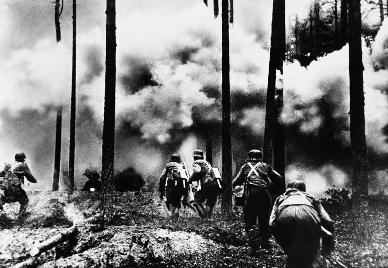 Troops advance through a burning forest on the northern section of the Russian front, where Finnish troops were helping Germany cut off communications between Moscow and Leningrad and surround the latter city, November 26, 1941.(AP Photo, File)