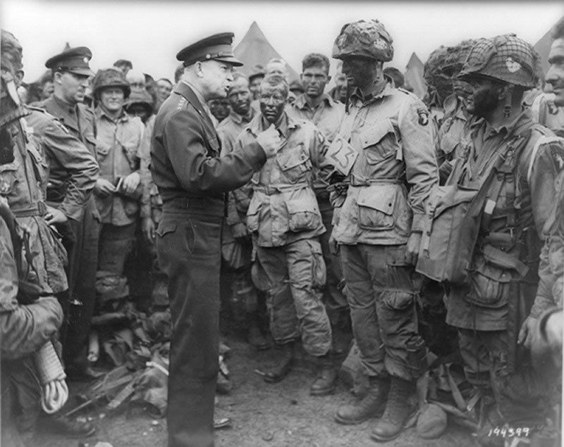 Supreme Allied Commander Gen. Dwight D. Eisenhower with US Army paratroopers of Easy Company, 502nd Parachute Infantry Regiment of the 101st Airborne Division, in England, June 5, 1944. Thomson Reuters