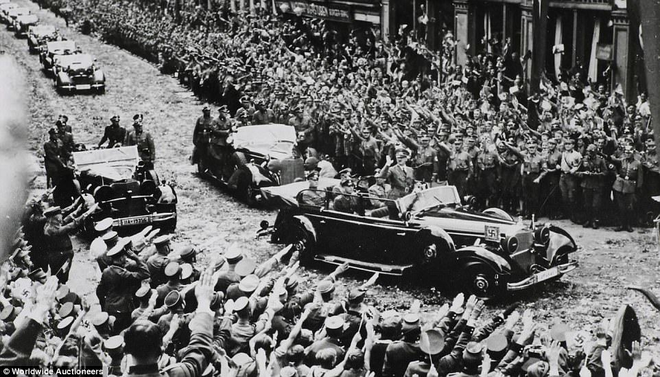 A car built for the Führer: Hitler's 1939 armor-plated 'super Mercedes' that carried him past cheering Berlin crowds after victory in France then seized by the US Army in 1945 goes under the hammer