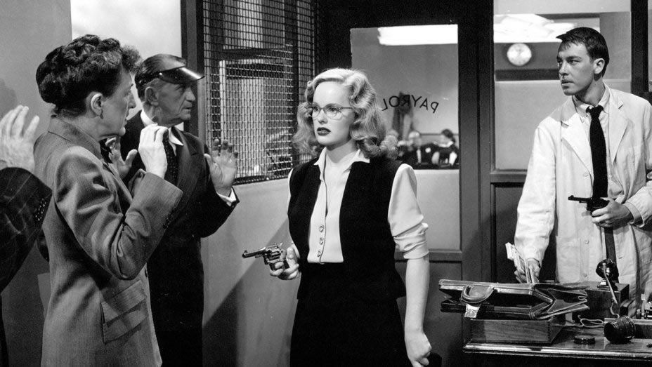Peggy Cummins and John Dall pull off a robbery in a scene from 'Gun Crazy.'