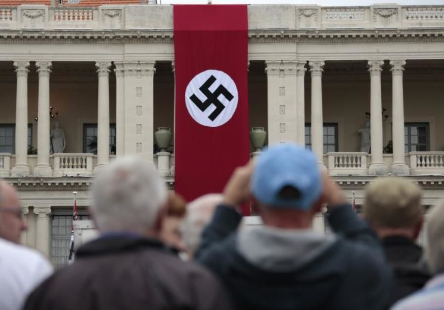 A Nazi swastika banner hangs on the facade of the Prefecture Palace in Nice which is being used as part of a movie set during the filming of a WWII film in the old city of Nice, France. (photo credit: Reuters)