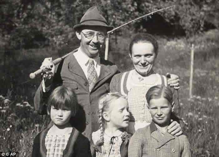 Heinrich Himmler in Valepp, Bavaria with his wife Marga, back right, his daughter Gudrun, front centre, his adopted son Gerhard, front right, and a friend of Gudrun's, front left, in 1935