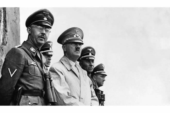 Himmler (left) was given the task of finding the 'final solution to the Jewish problem' by Adolf Hitler (right)