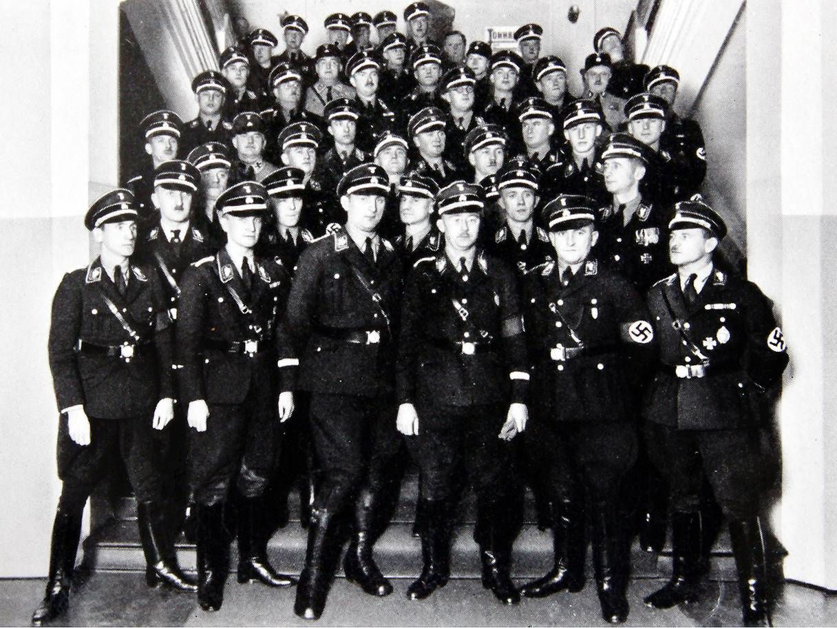 Heinrich Himmler (front row, centre, with glasses) with fellow SS men – his daughter wasn't the only one linked to him to find their way into Germany's postwar intelligence (Rex)