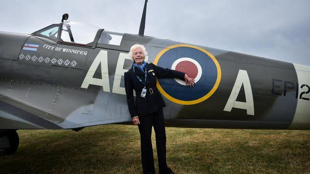 In this file photo dated Aug. 18, 2015, showing RAF Veteran World War II pilot Mary Ellis posing with a Spitfire at Biggin Hill Airfield, England. The Second World War pilot Ellis has died at the age of 101, is is announced Thursday July 26, 2018. Mary Ellis delivered spitfires and bombers to the front line during the war as a member of the Air Transport Auxiliary (ATA), flying over 1,000 planes during the conflict before moving to the Isle of Wight to manage Sandown airport from 1950 to 1970. (Gareth Fuller/PA via AP) Associated Press
