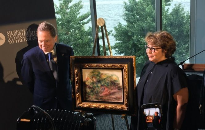 Sylvie Sulitzer was presented with the painting at a ceremony in New York
