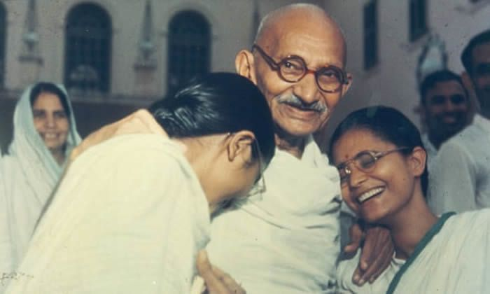 Gandhi with two of his granddaughters, Delhi, 1948. Photograph: Alamy