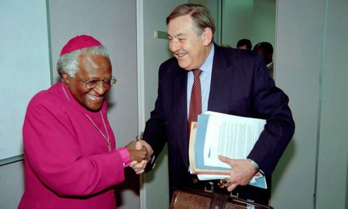 Botha shakes hands with Desmond Tutu at the Truth and Reconciliation Commission Hearings in Johannesburg in 1997. Photograph: Odd Andersen/AFP/Getty Images
