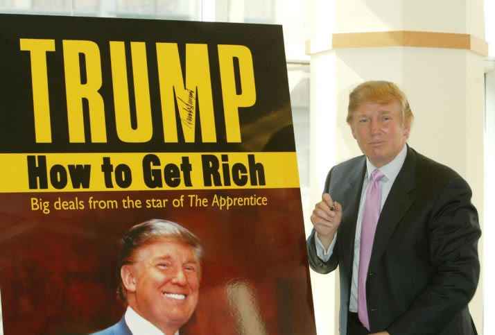 """Donald Trump pauses for a moment after signing a poster depicting the over of his new book """"How To Get Rich"""" in 2004   Peter Kramer/Getty Images"""