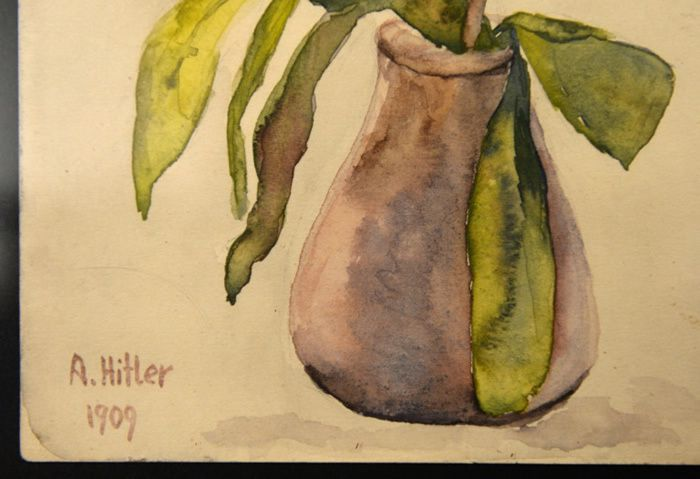 A watercolour still life signed by A. Hitler at the Weidler auction house in Nuremberg in 2015 CHRISTOF STACHE (AFP/File)