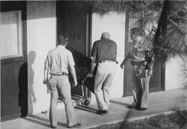 Authorities remove the body of actor Bob Crane from a Scottsdale apartment where he was discovered beaten to death June 29, 1978. The Republic