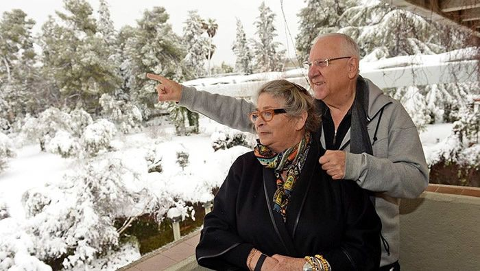 File: President Reuven Rivlin and his wife Nechama look at the snow-covered garden at the President's Residence in Jerusalem after a snowstorm hit the capital in February 2015. (Haim Zach/GPO)