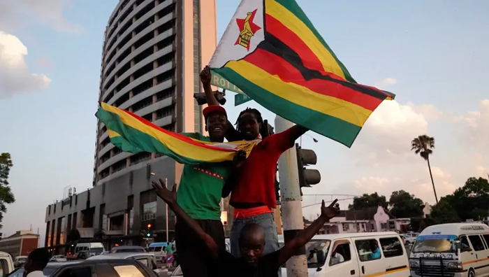 People and soldiers celebrated in Harare in 2017 after the resignation of Mugabe. (Marco Longari/AFP/Getty Images)