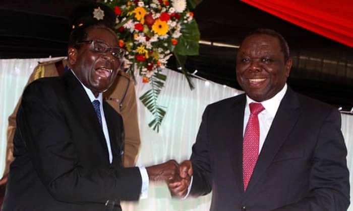 Robert Mugabe as president and Morgan Tsvangirai as prime minister after signing Zimbabwe's new constitution into law in 2013. Photograph: Philimon Bulawayo/Reuters