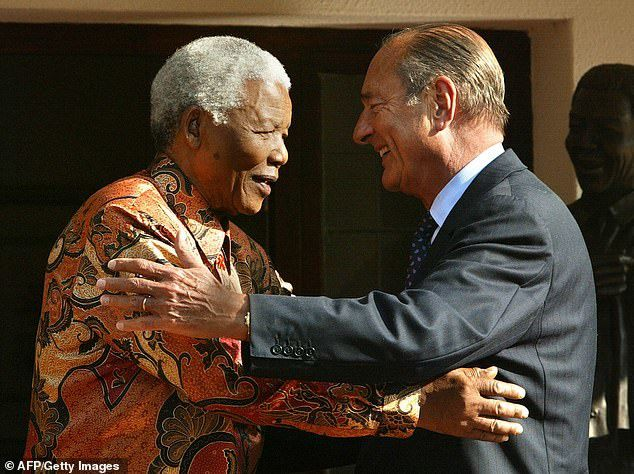 Chirac meets former South African leader Nelson Mandela in Johannesburg in September 2002, the year Chirac won re-election as French President