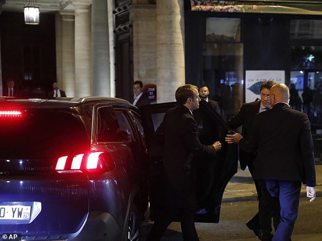 French President Emmanuel Macron, center, arrives at the home of Jacques Chirac to pay tribute to him yesterday evening