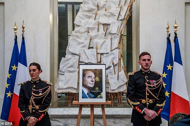 Thousands queued to write tributes in a condolence book at the Presidential Eylsee Palace in Paris, which was placed in front of an image of him and protected by guards