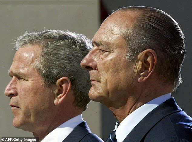 Chirac with then-U.S. President George W. Bush at a D-Day wreath laying ceremony in 2004. The Frenchman's opposition to the Iraq War weakened their relationship