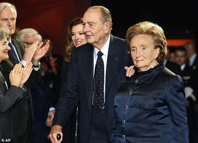 Jacques Chirac in 2013 with his wife Bernadette, whom he married in 1956 - a marriage which lasted until his death despite his serial philandering