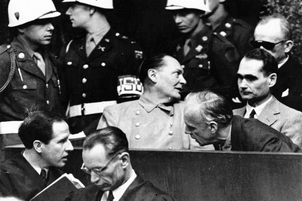 FILE - In this March 27, 1946 file photo, Nazi German Foreign Minister Joachim von Ribbentrop, right, leans in front of Rudolf Hess, Hitler's deputy, to confer with his lawyer, lower left, while Hermann Goering, center, chief of the German air force and one of Hitler's closest aides, turns to talks with Karl Doenitz, rear right, during the Nueremberg war crime trial session. Audio recordings from the historic Nuremberg trials will be made available to the public for the first time in digital form after a nearly two-year digitization process conducted in secret. The files capture around 1,200 hours of the high-profile trial of Nazi leaders in Nuremberg, Germany from 1945 to 1946. (AP Photo, File) The Associated Press
