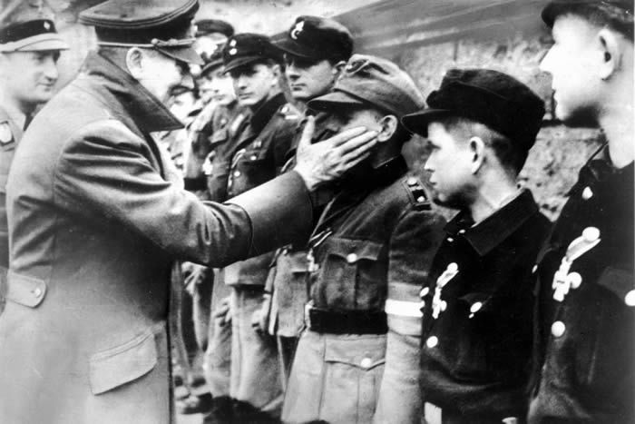 Adolf Hitler greeting one of the members of the Hitler Youth in 1945. DPA stock photo