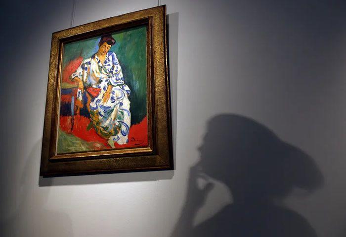 Un portrait rare de la femme de Matisse d'André Derain exposé avant la vente aux enchères chez Christie's Londres, Angleterre, avril 2013• Crédits : Peter Macdiarmid - Getty