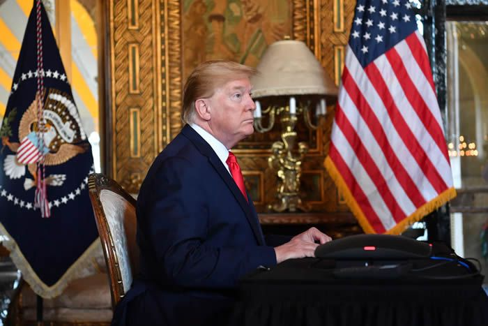 President Donald Trump makes a video call to the troops stationed worldwide at the Mar-a-Lago estate in Palm Beach, Fla., on Dec. 24, 2019.  Photo: Nicholas Kamm/AFP/Getty Images