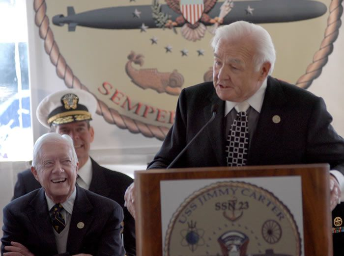 Mr. Turner spoke in 2005 at a submarine commissioning ceremony in Groton, Conn., that was also attended by Mr. Carter.Credit...Jack Sauer/Associated Press