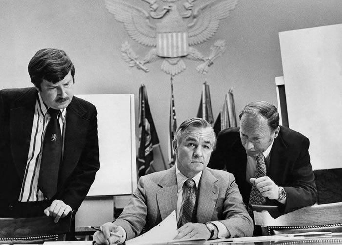 Mr. Turner with aides in 1977. He later wrote that the C.I.A. he inherited was demoralized and disorganized after having been dragged into the Watergate scandal during the Nixon administration.Credit...George Tames/The New York Times