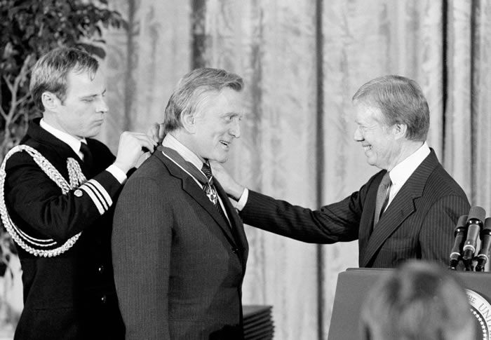 President Jimmy Carter awarded Mr. Douglas the Medal of Freedom, the nation's highest civilian honor, during a ceremony at the White House in 1981.Credit...Ira Schwarz/Associated Press